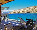 Matala Caves Seafront Apartment looks across the bay to the ancient caves on the rocky peninsula