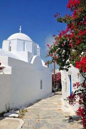 Amorgos Island - a white washed village street scene with pink bougainvillea
