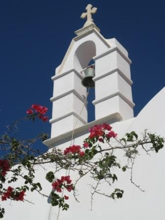 Mykonos Greece - I love this image - bright colours against the pristine white church, it seemed everywhere I looked in Mykonos there was symmetry such as this