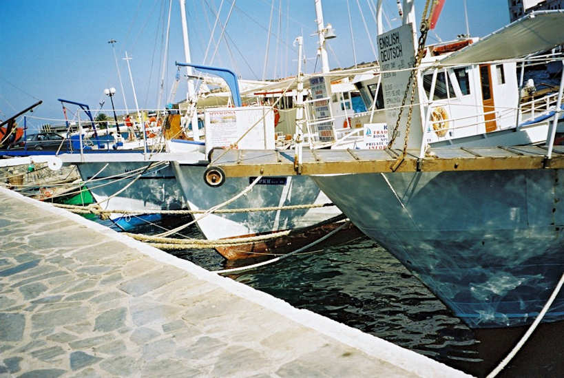 The marine harbour services Mirabello Bay - fishing boats with sunshine reflecting on the hulls