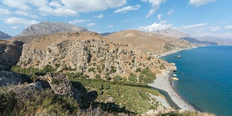 Preveli Crete - palm forest and beach at the southern end of Kourtaliotiko Gorge