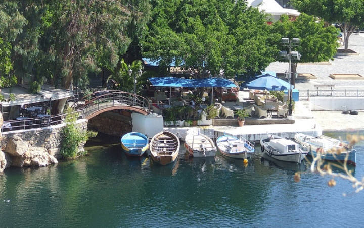 Cafes line the edges of the lake in central Agios Nikolaos, Crete