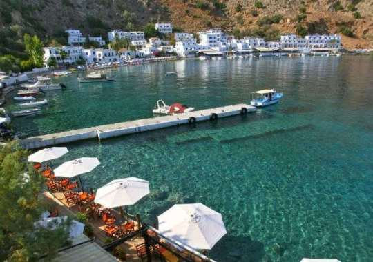 An idyllic Greek seaside village in the south of Chania. Get there by foot or by ferry.