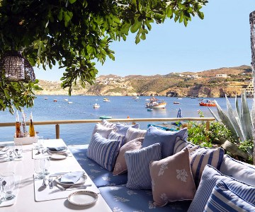 Sit at this outdoor restaurant at the Out of the Blue Resort overlooking Agia Pelagia Bay
