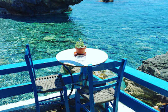 There is a small cove with a cozy local taverna by the sea at Agia Fotini