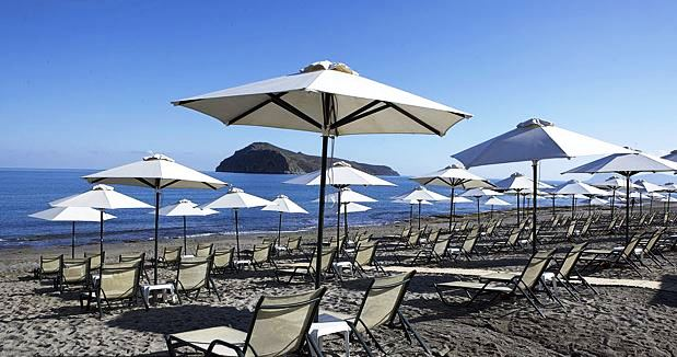 White sand beach with umbrellas and lounges, Chania