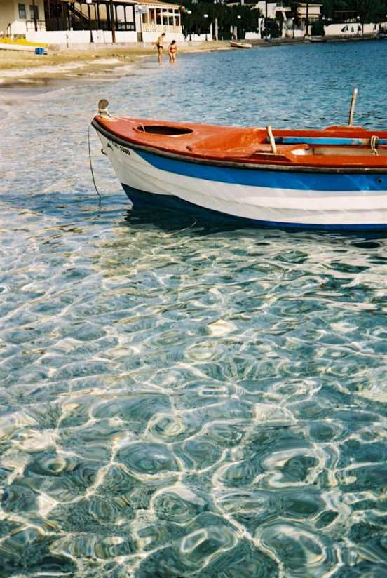 Agia Pelagia Crete - crystal clear waters and fishing boat