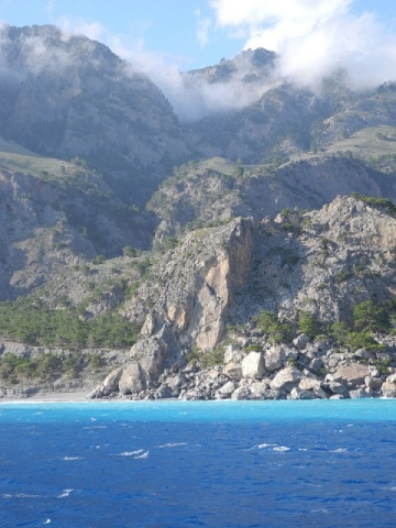 Take a ferry along the south coast of Crete - view the White Mountains falling into the sea