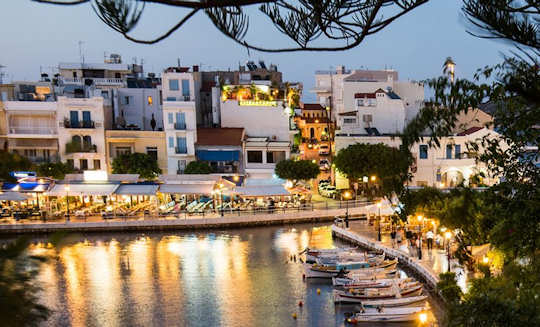 Visit the very Greek town of Agios Nikolaos to enjoy the restaurants and tavernas by the lake and the harbourside