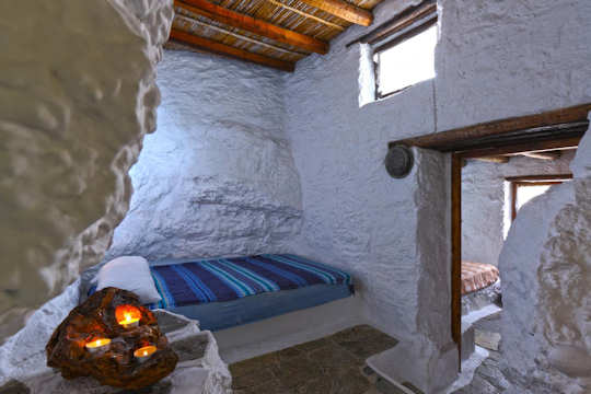 Traditional rooms at the Aspros Potamos village retreat