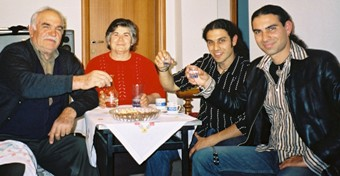 Stin Yiamas! Taso and Toli with friends in a Cretan village