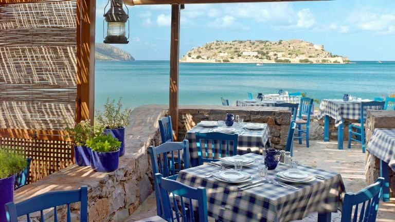The Blue Door taverna within the Blue Palace Resort & Spa is a traditional taverna overlooking the island of Spinalonga