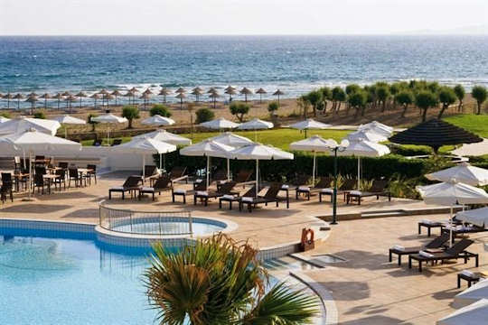 Candia Maris Resort sits directly on the long sand and pebble beach of Ammoudara