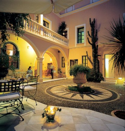 The delightful, atmospheric courtyard of the Casa Delfino luxury hotel in Chania Old Town