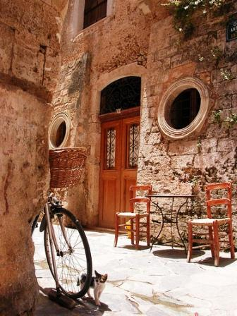 Chania old town walls, a cycle and kitten (image by Irene Shin)
