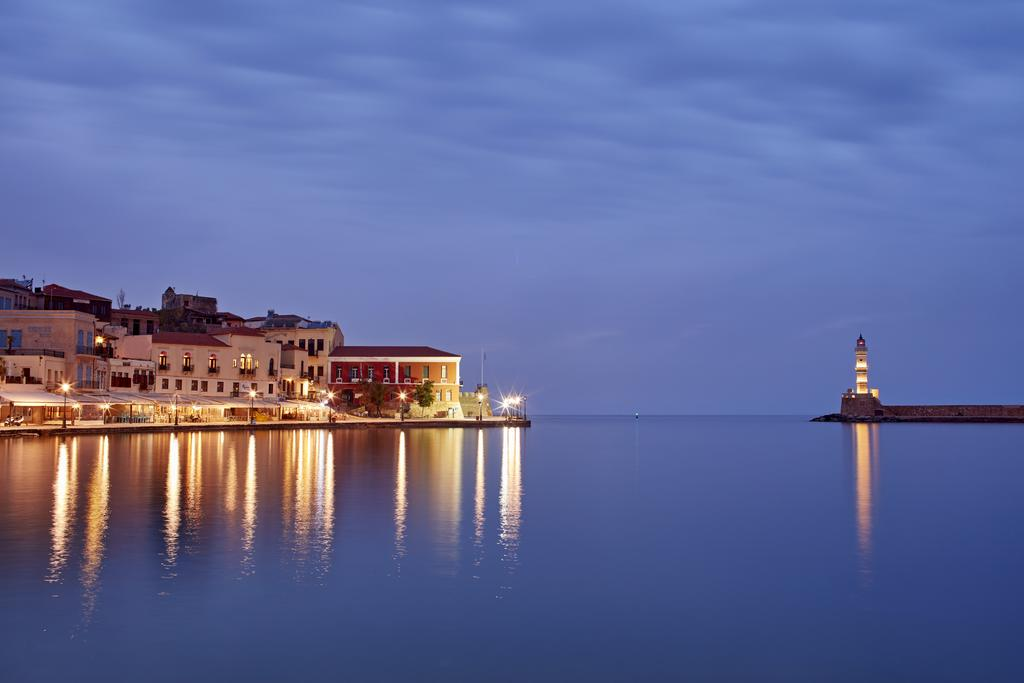 Chania Harbour at Dusk - view to the lighthouse and the Domus Renier Boutique Hotel