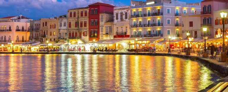 Chania in Crete - the romance of lights on the harbour at dusk