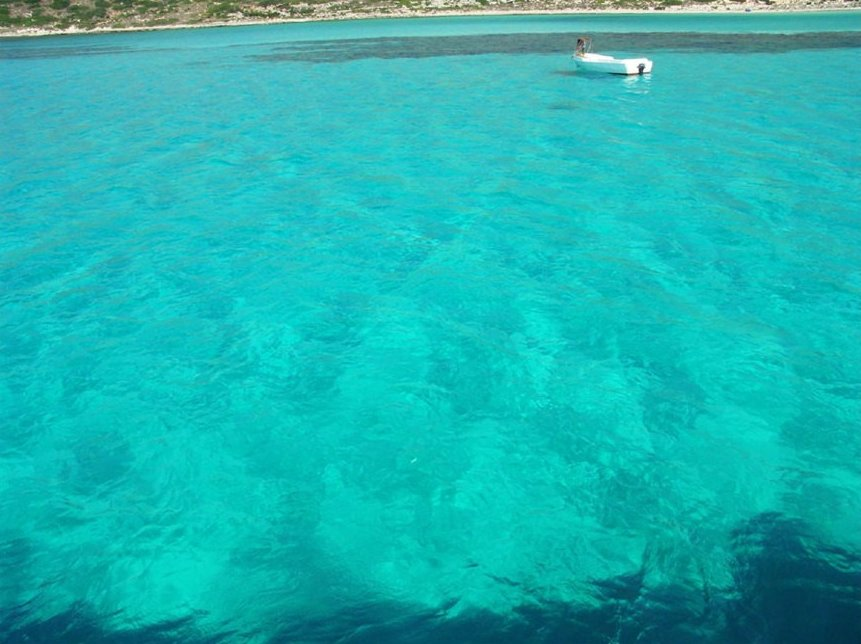 Elafonisi Beach - clear azure waters of the Mediterranean - little fishing boat