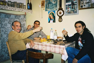 Stin Yiamas! Taso and Toli drink with a friend in a village in Crete