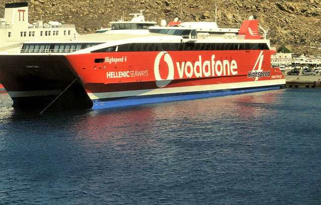 Ferries to Crete - big red Hellenic Seaways ferry docked at Mykonos island