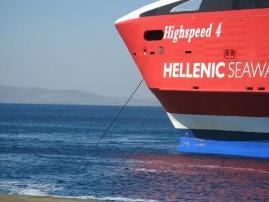 Mykonos ferry red against the blue of the Med