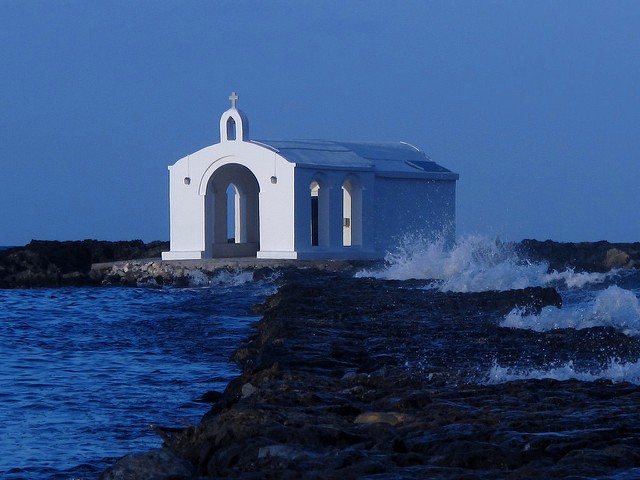 Romantic dusk envelopes the little chapel of Agios Nikolaos at Georgioupolis
