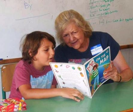 A volunteer teaching English in Greece