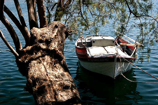 Fishing Boat in Lake Voulismeni, Agios Nikolaos, Crete (image by Yashima)