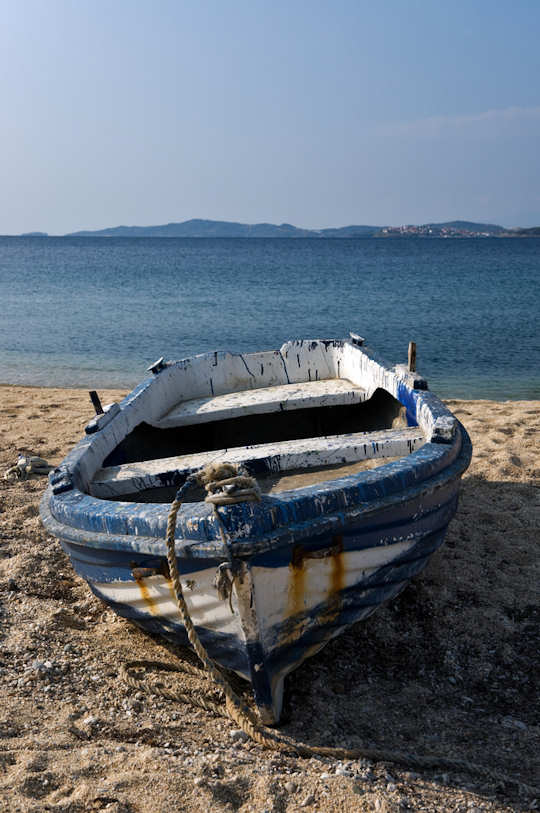 Old and Tired blue and white wooden boat, Ammouliani, Greece (image by Horia Varlan)