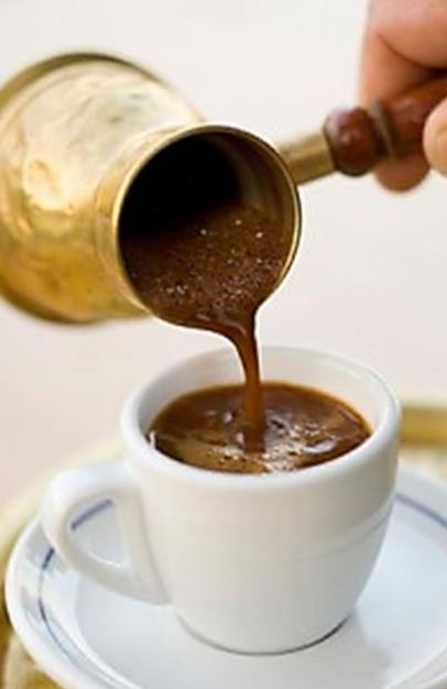 Greek coffee being poured from a briki μπρίκι