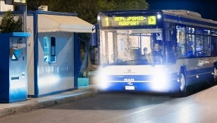 Heraklion city bus and bus-stop at night