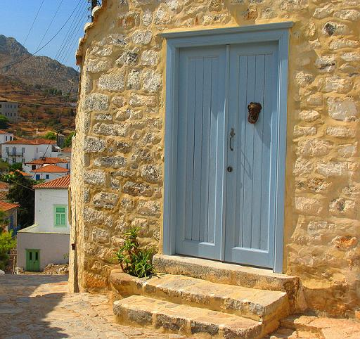 Blue wooden door on stone restored home (Image by Byrdiegirl)