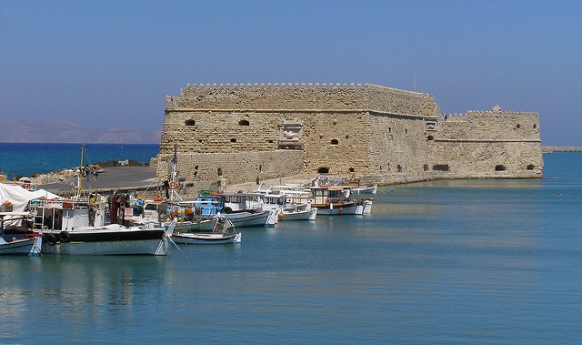 The old fort and fishing boats in the harbour
