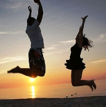 A couple jumping in the sunset