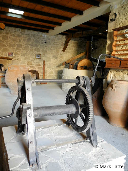 The rotating hand crank for the top of a water well, previously used in the village, now on display at the Fabrica