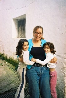 Katia with the girls in the village laneway...