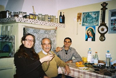 Stin Yiamas! Toli and Katia drink with a friend in a village in Crete
