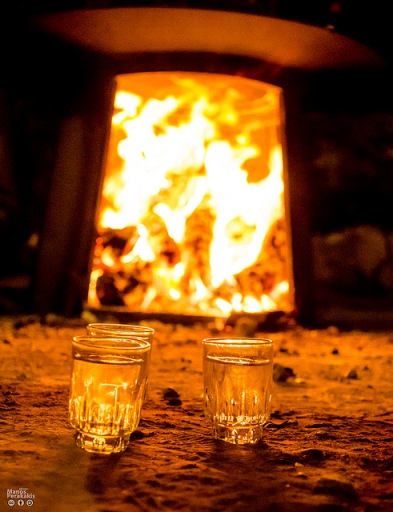 Kazani fire and glasses of raki (image by Manos Perakakis)