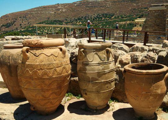Knossos Palace site showing some large ancient storage jars 'pithoi' and the valley