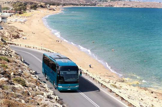 Bus on the highway next to the beach in Crete