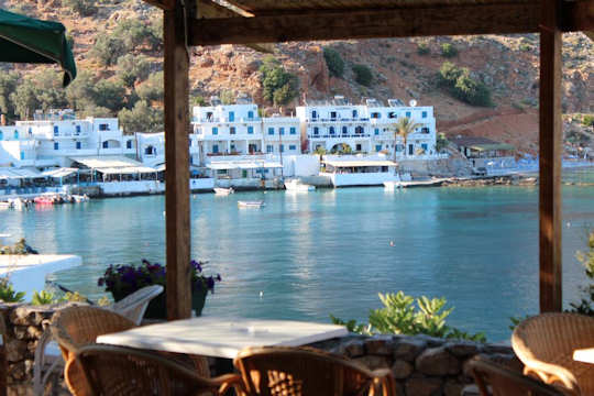 Porto Loutro on the western side of the bay has lovely views from its own taverna across the bay to the village