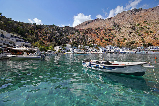 In Loutro, a tiny little white fishing village in the south of Crete, see wooden fishing boats on the clear turquoise waters (image by Miguel Virkkunen Carvalho)