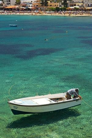 Clear waters and fishing boat Crete (Image by Micael Goth)