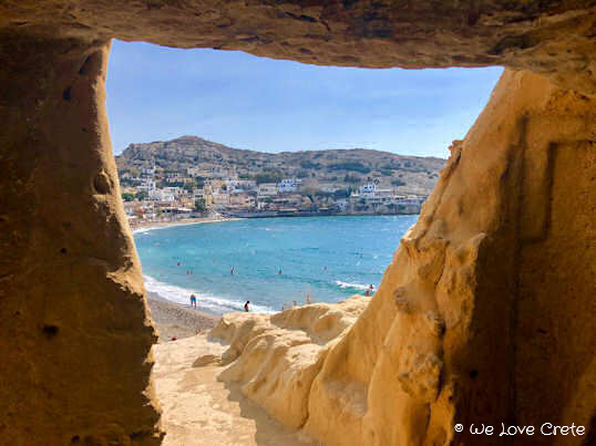Matala Beach - here the bay can be seen framed by the walls of one of the ancient burial caves on the peninsula