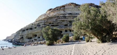 The western end of Matala Beach with the caves and tamarisk trees