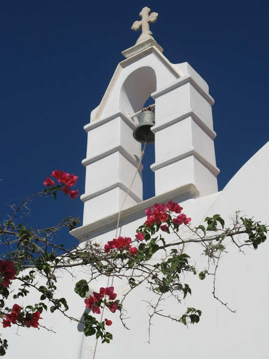 Mykonos white church spire with bougainvillea