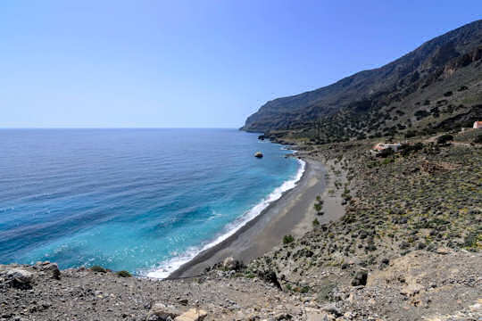 Pachia Ammos Beach, which means 'big sand' beach, this is a magnificent wide grey sandy beach with pebbles, no buildings and just pure seaside and wide open spaces for your heart to run wild.