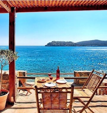 Cottages by the Sea at Plaka near Elounda have their own access to the sea and views across the bay to Spinalonga Island