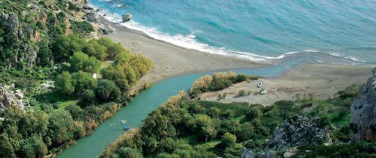 Kourtaliko Gorge meets the sea at a lagoon of palms and a beautiful beach