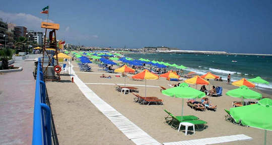 Rethymnon Beach is an organised beach - this view looking back to the old town and fortezza